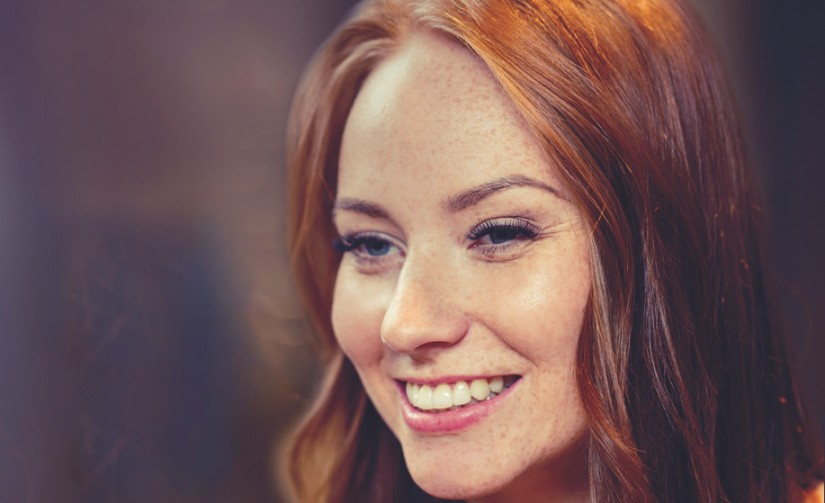 female, gender, portrait and people concept - smiling happy young redhead woman face